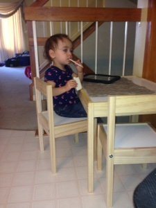 Eating at her big girl table