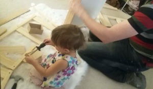 Helping daddy build her furniture